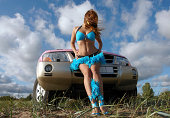 Girl and pink Mitsubishi in landscape