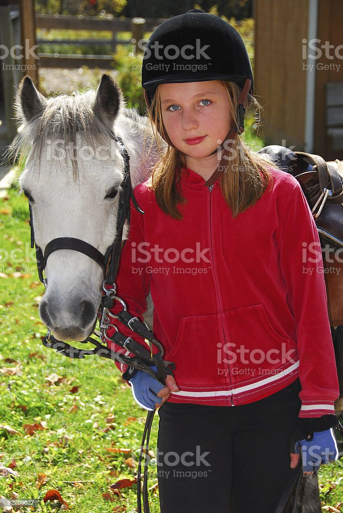 Girl and pony royalty-free stock photo