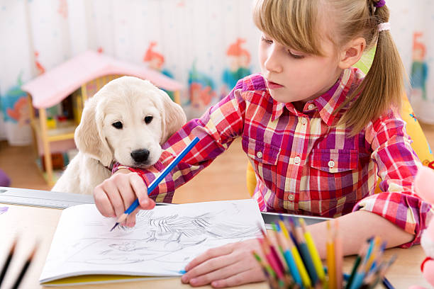 Girl and puppy friends stock photo