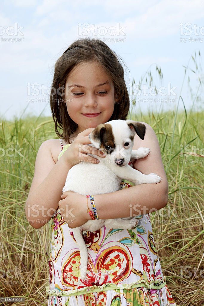 Girl and puppy. royalty-free stock photo