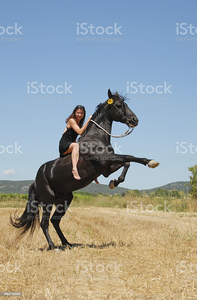 girl and rearing horse royalty-free stock photo