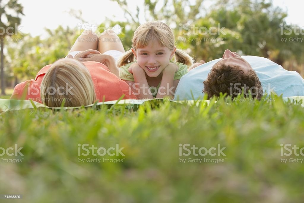 Girl and sleeping parents royalty-free stock photo