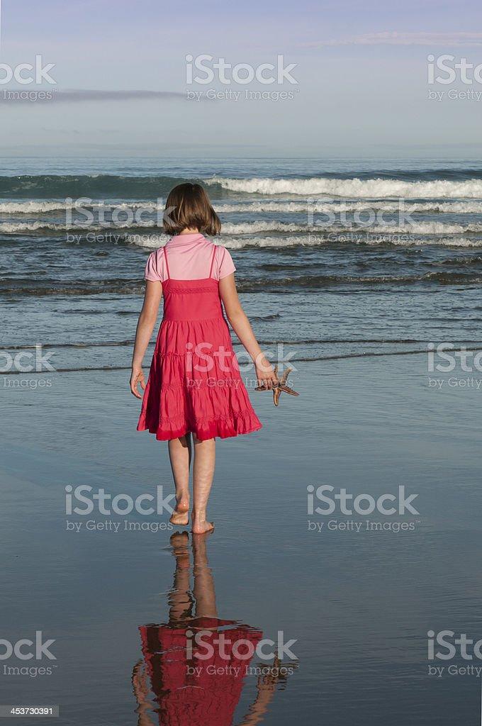 Girl and Starfish royalty-free stock photo