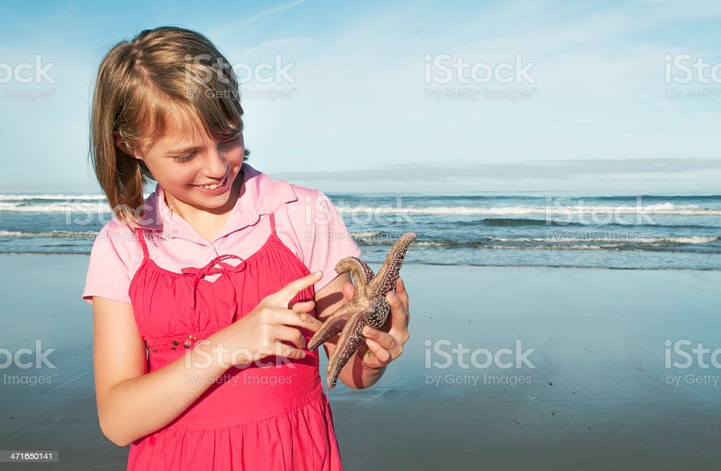 Girl and Starfish royalty-free stock photo