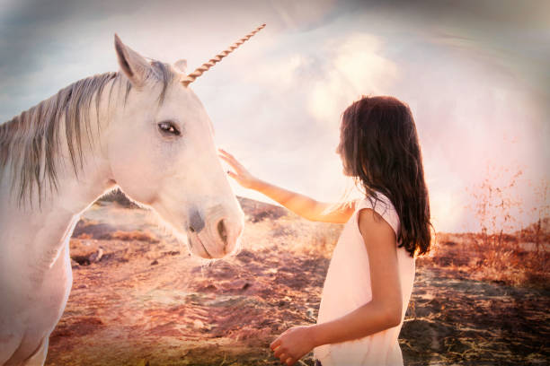 girl and unicorn fantasy - unicorns stock photos and pictures
