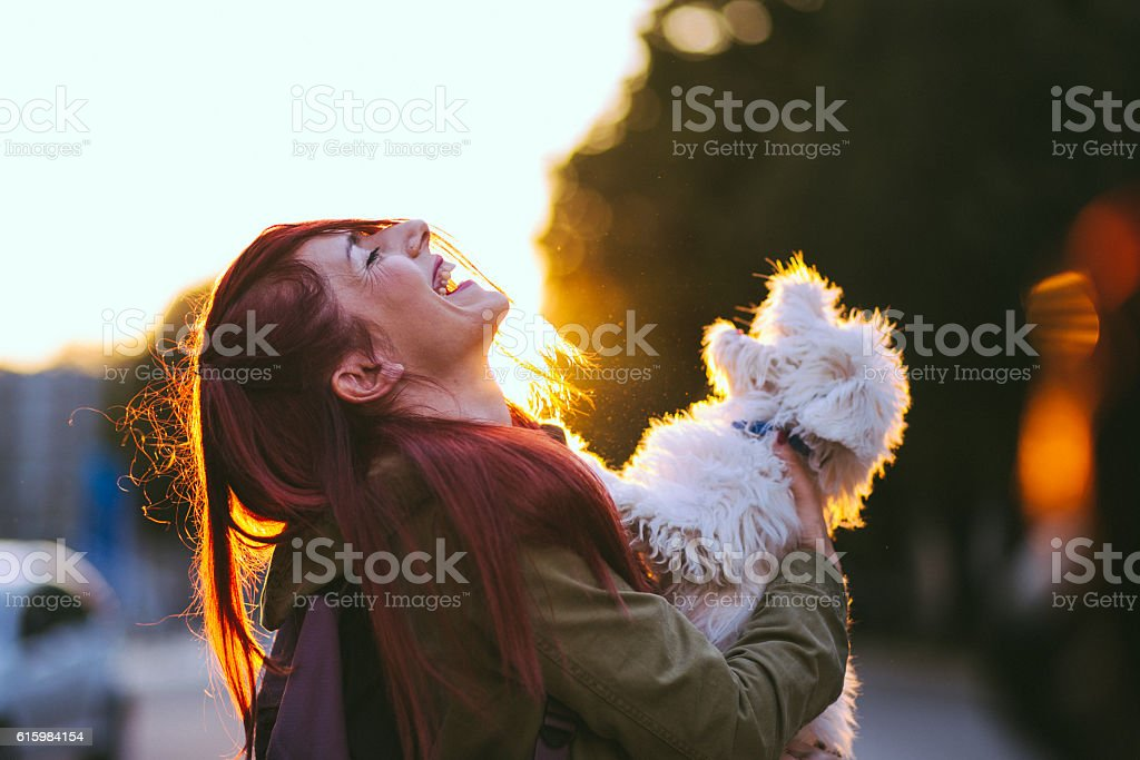 It seems like this two friends, the redheaded girl and a fluffy white...