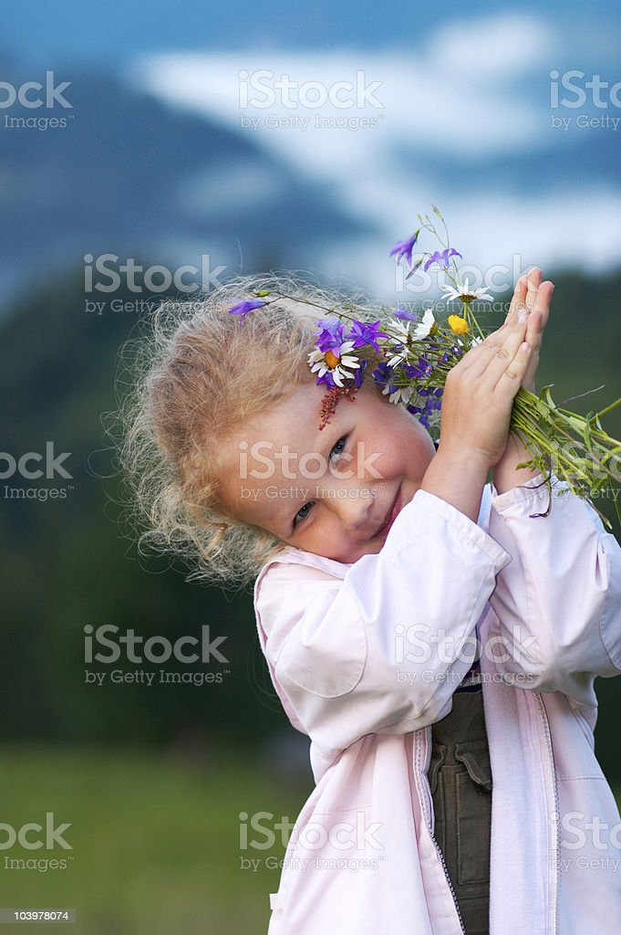 Girl and wildflowers royalty-free stock photo