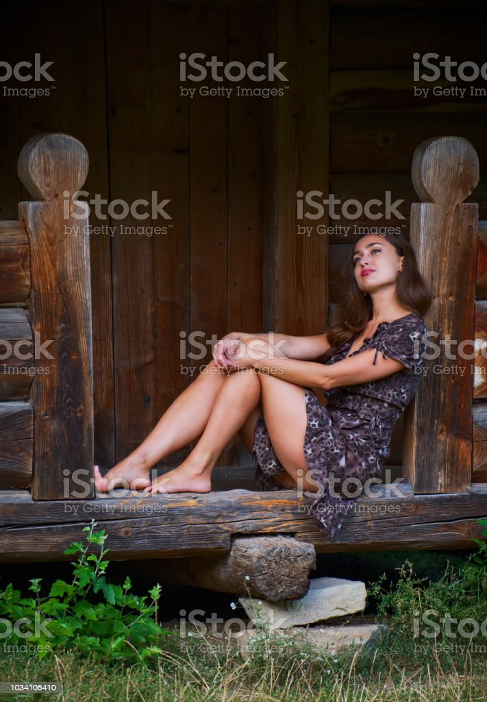 Girl and wooden old house stock photo