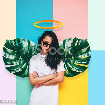 istock girl angel with wings made of palm leaves 924828694