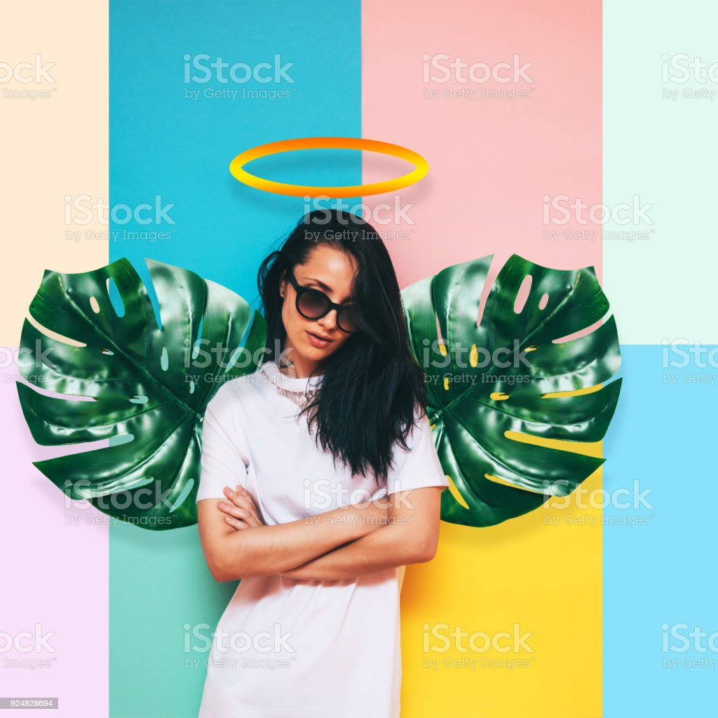 girl angel with wings made of palm leaves stock photo