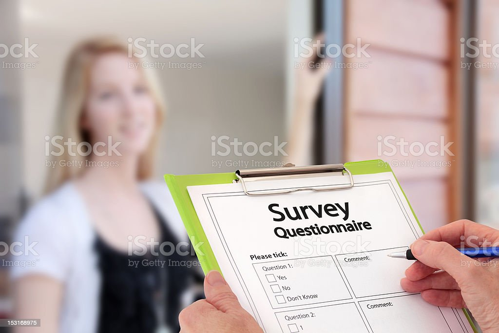 Girl Answering Market Research Survey Questions at the Door stock photo