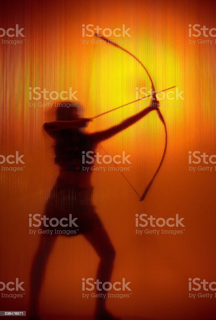 Girl archer silhouette stock photo