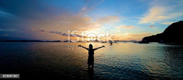 istock Girl arms open wide in El Nido 523087657