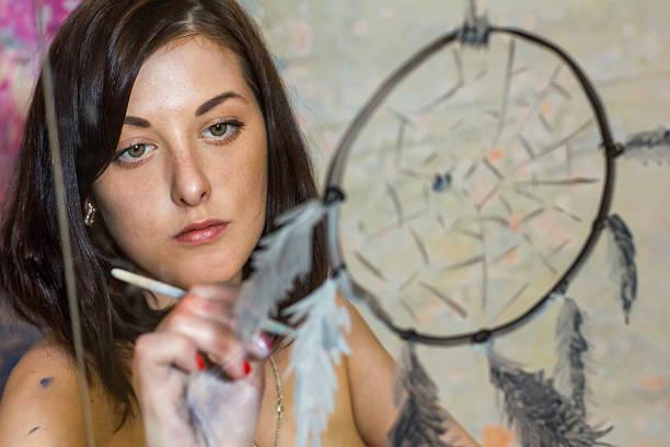 girl artist painting on glass dream catcher - traumfänger tattoos stock-fotos und bilder