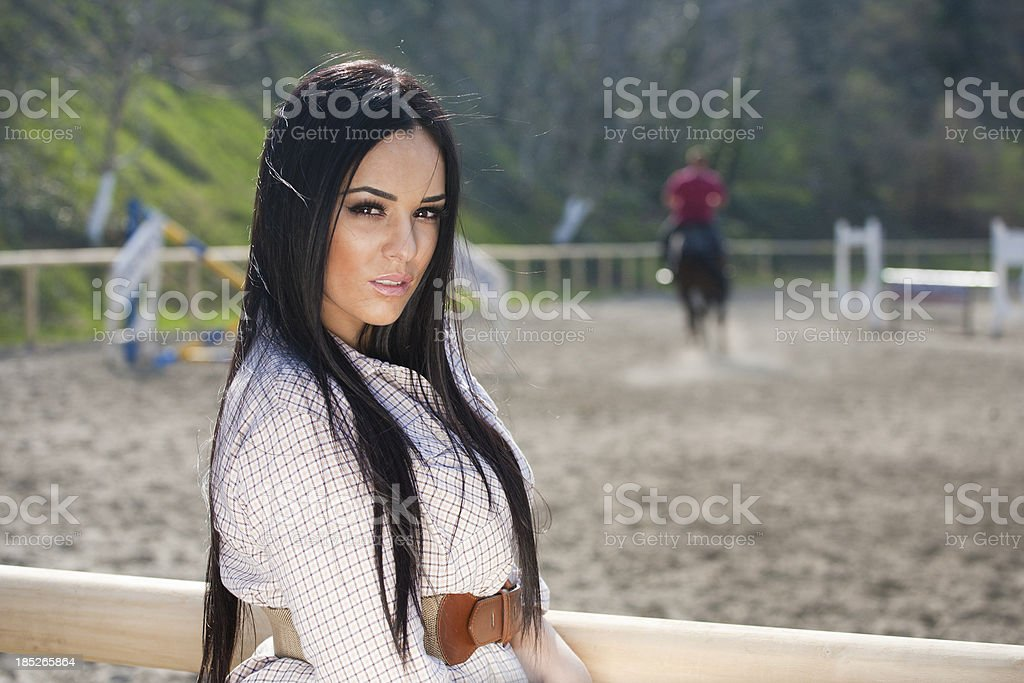 Girl at a horse track stock photo