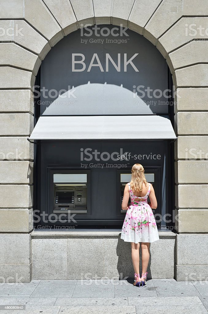 Girl at ATM stock photo