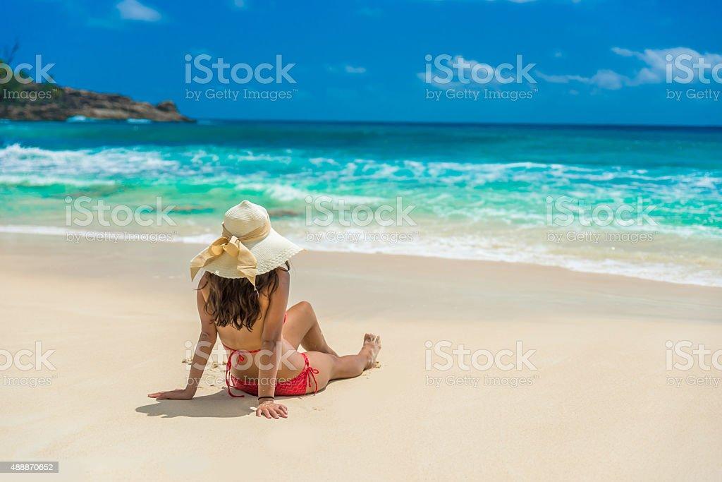 Girl at beautiful  Beach in Seychelles, Anse Intendance stock photo