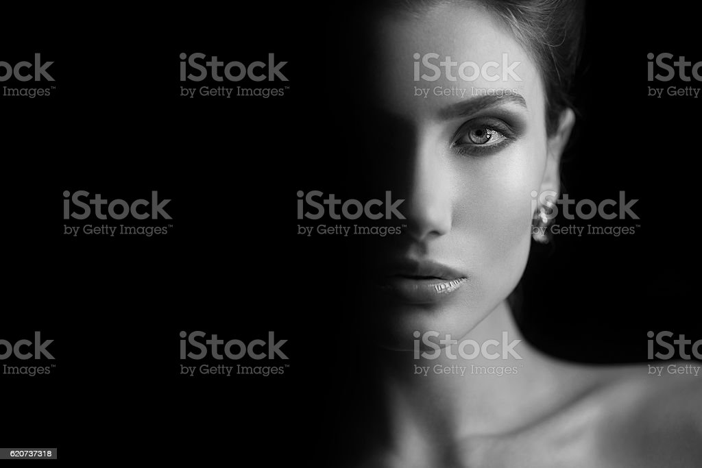 Girl at black background. stock photo