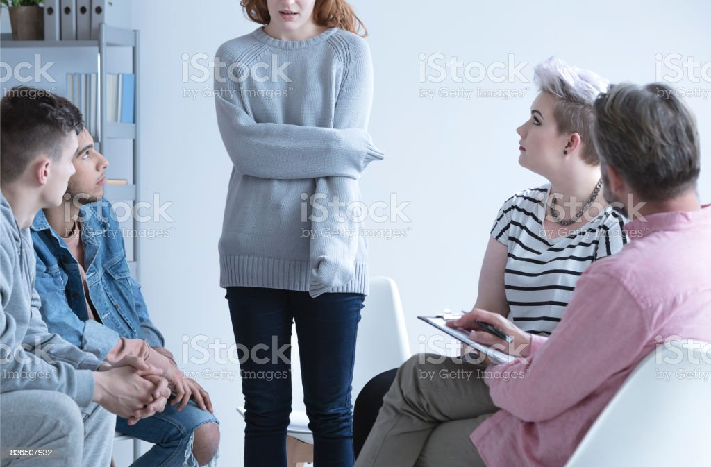 girl at group therapy stock photo
