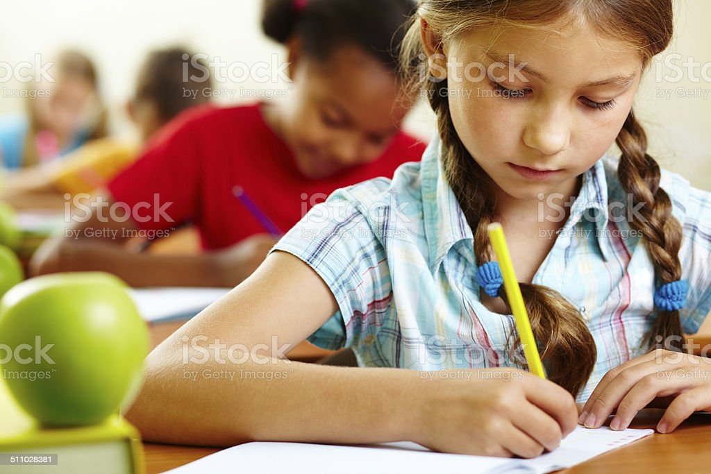Girl at lesson stock photo