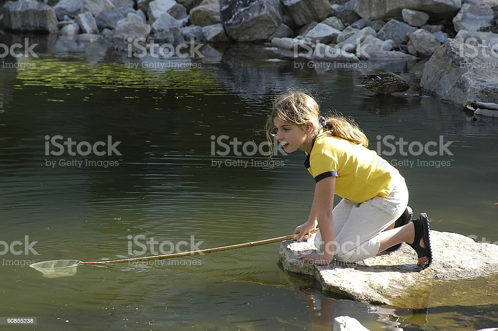 girl at pond royalty-free stock photo