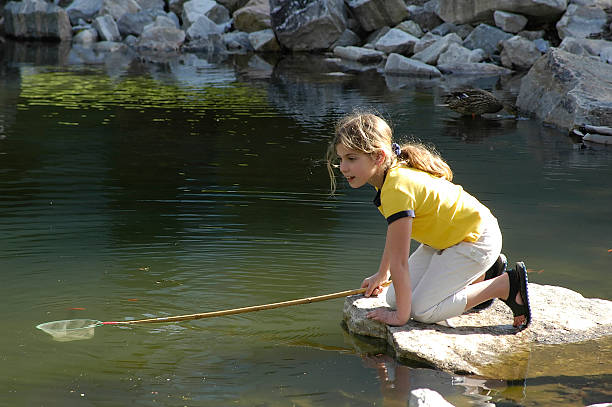 girl at pond stock photo