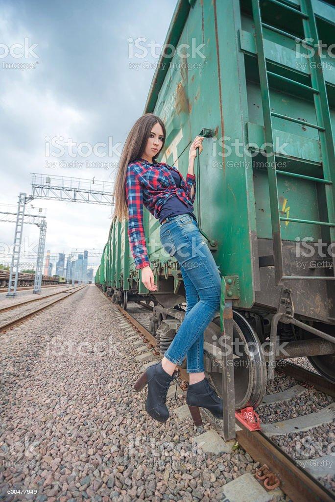 Girl at railroad stock photo