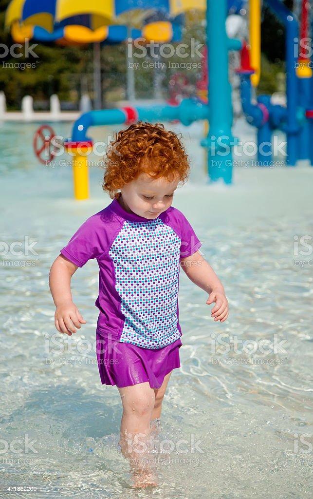 Girl at Splash Pool royalty-free stock photo