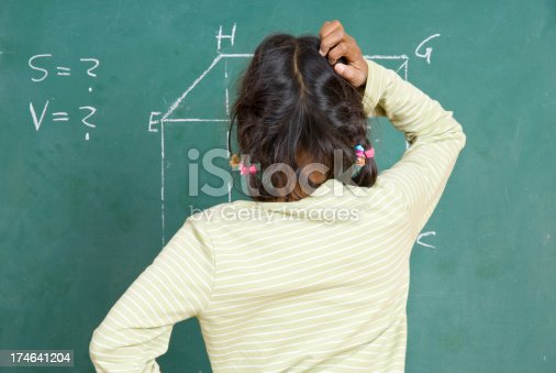 909927050 istock photo girl at the blackboard 174641204