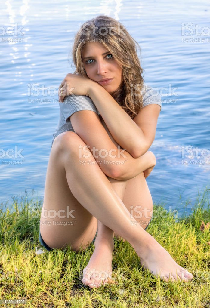 A girl at the edge of the river
