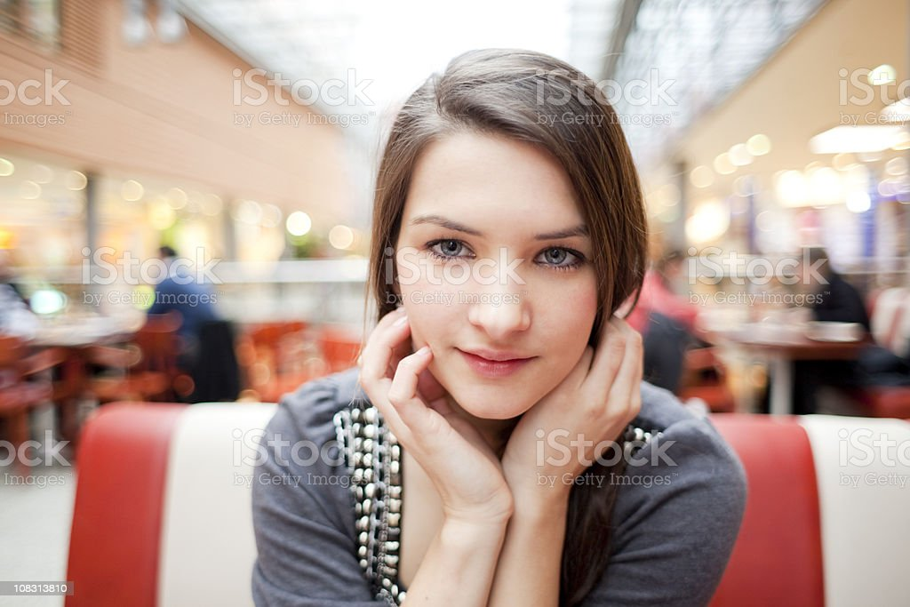 Girl at the Food Court in Shopping Mall stock photo