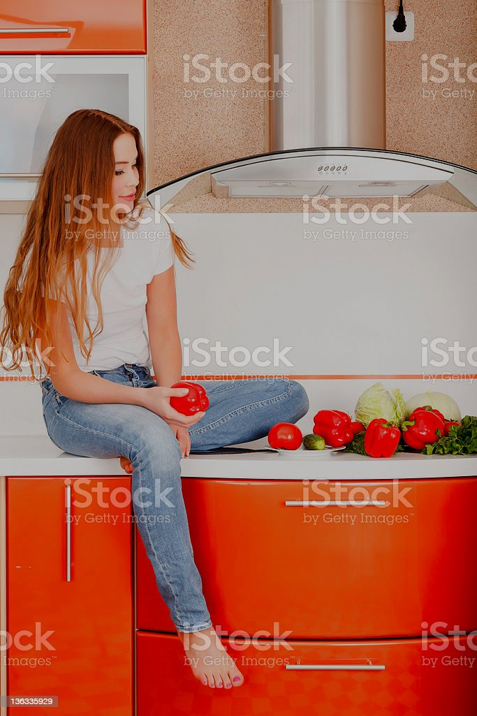 Girl at the kitchen royalty-free stock photo