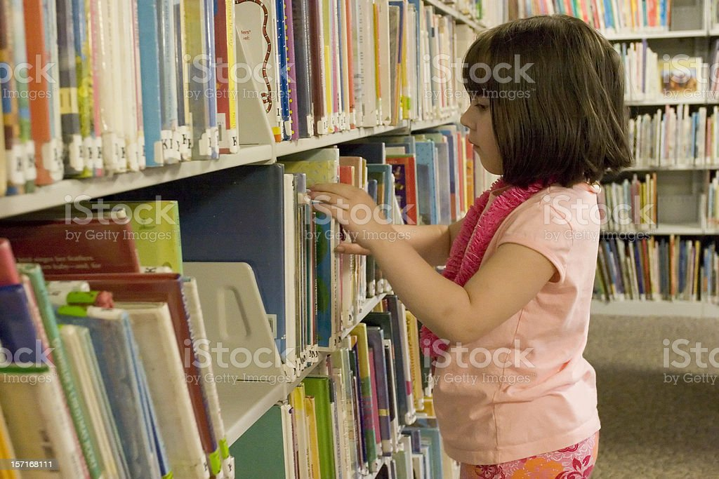 Girl at the public library royalty-free stock photo