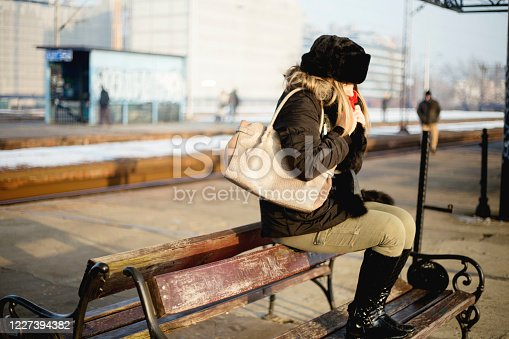 Girl at the train station waiting for the train