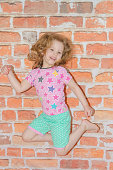 istock girl, baby on brown brick wall background 951982142