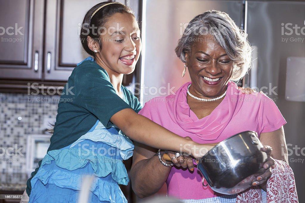 Girl baking with grandmother stock photo