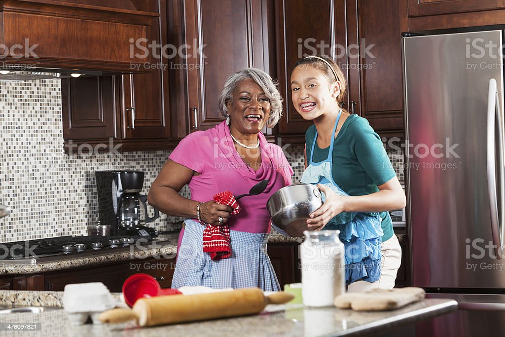 Girl baking with grandmother royalty-free stock photo