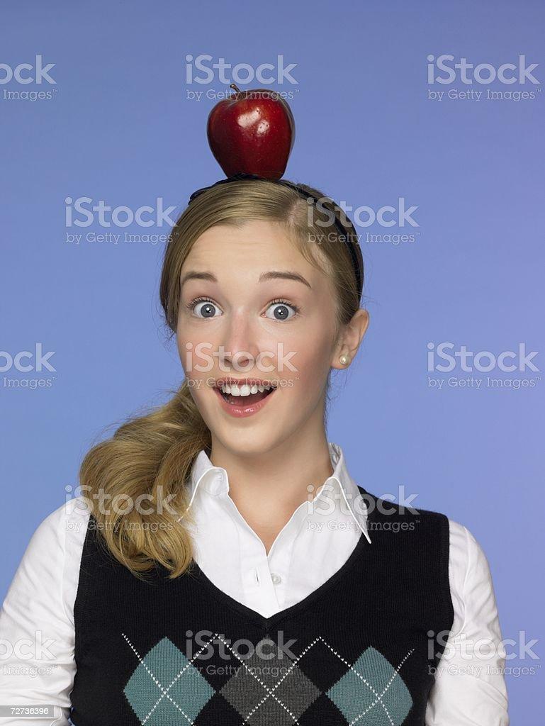 Girl balancing an apple on her head royalty-free stock photo