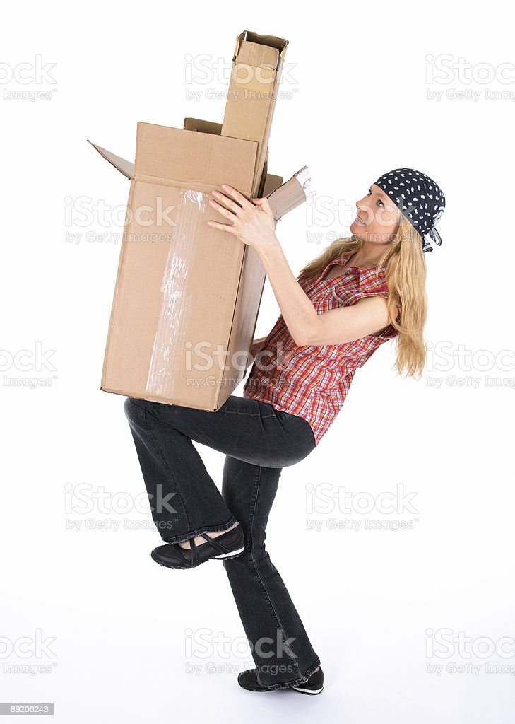 Girl balancing with cardboard boxes royalty-free stock photo
