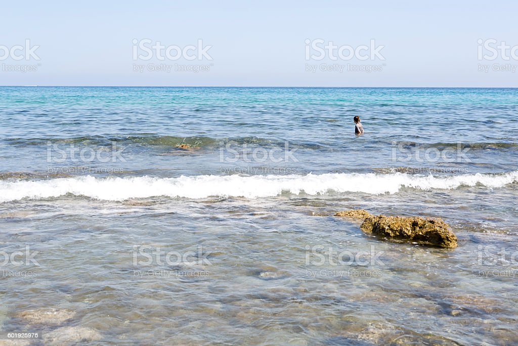 girl bathing in the sea stock photo