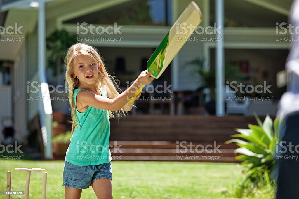 girl batting at cricket stock photo