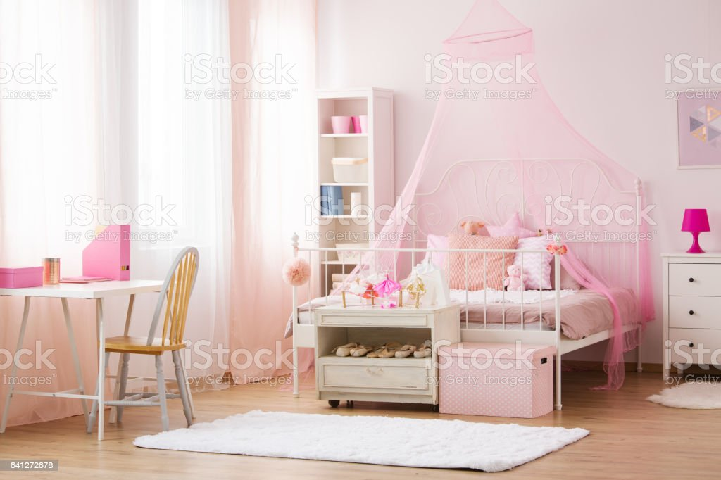 Girl bedroom with canopy bed stock photo