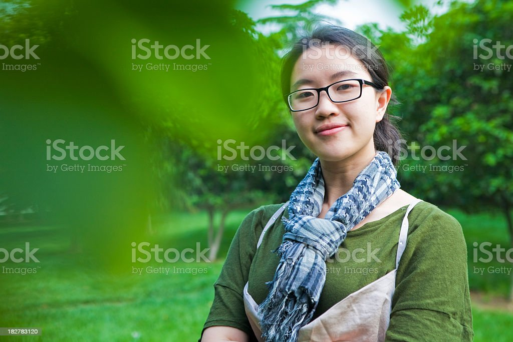 Girl behind the green royalty-free stock photo