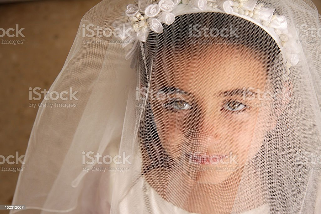 Girl behind veil stock photo