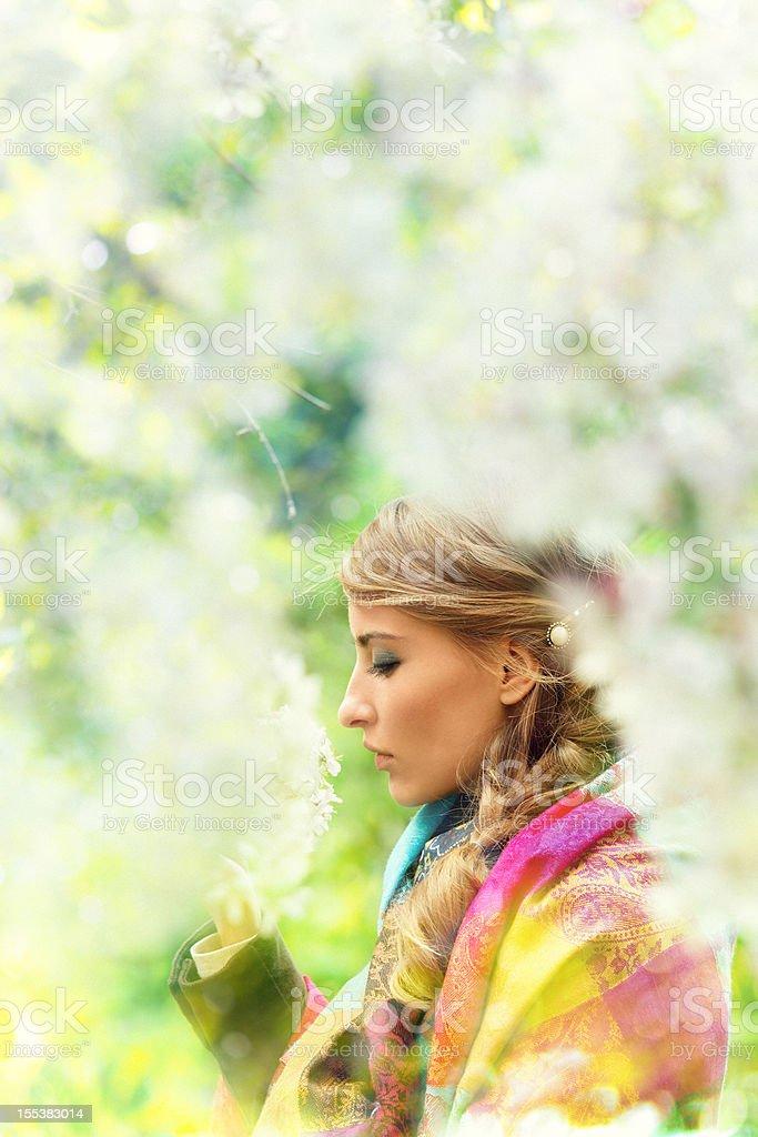girl between flowers royalty-free stock photo