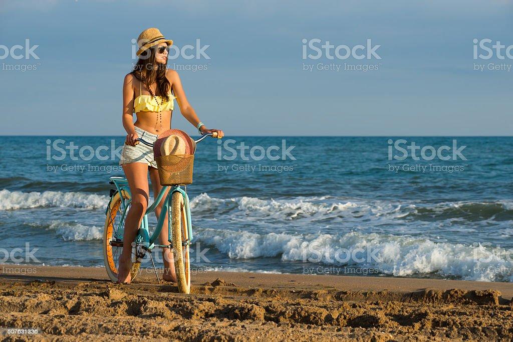 girl, bike and sea stock photo