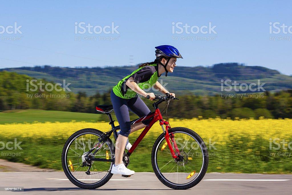 Girl biking stock photo