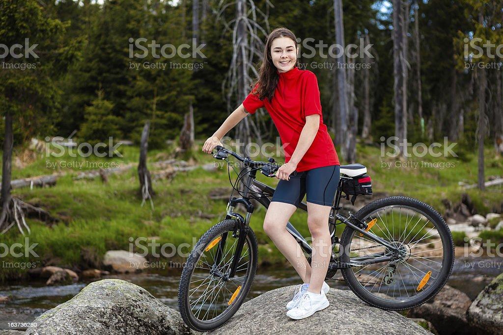 Girl biking royalty-free stock photo