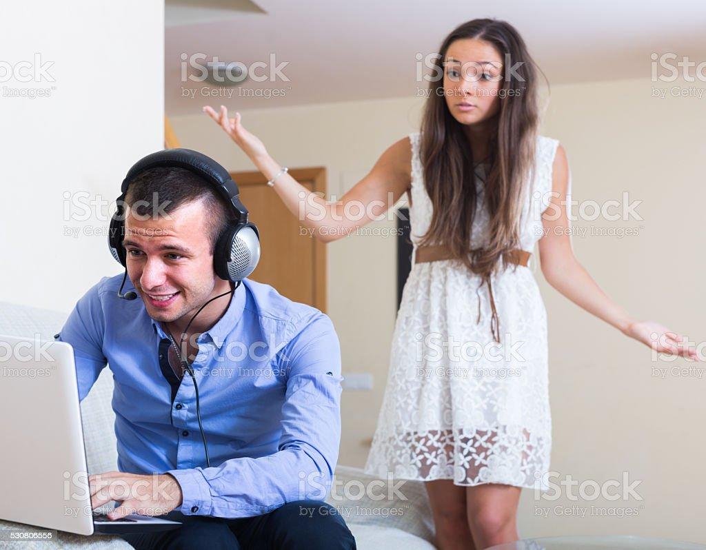 girl blaming boyfriend in visiting date sites stock photo