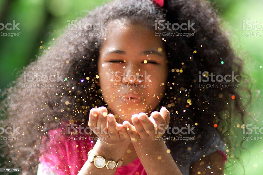 Girl blew glitter stock photo